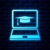 Glowing Neon Graduation Cap And Laptop Icon Isolated On Brick Wall Background. Online Learning Or E- poster