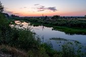Sunset Over The River. Little River In The Field. Forest And River. poster
