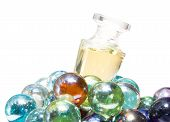 Luxury Perfume On Heap Of Colorful Glass Balls
