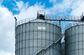 Agricultural Silo At Feed Mill Factory. Big Tank For Store Grain In Feed Manufacturing. Seed Stock T poster
