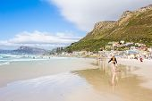 Girl Walking On The Beach Carrying A Plastic Packet On A Sunny Summers Day At Surfers Corner In Muiz poster