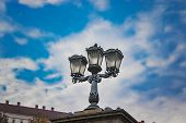Beautiful Street Lamp With A Cloudy Budapest Day In The Background. Location Liberty Bridge In Budap poster