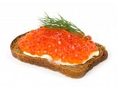 Red caviar with bread and butter on the white background