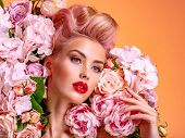 Beautiful white girl with flowers. Stunning blonde girl with big bouquet flowers of roses. Closeup f poster