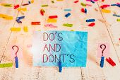 Handwriting Text Do S And Don Ts. Concept Meaning Rules Or Customs Concerning Some Activity Or Actio poster