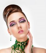 Sensual Brunette With Bright Purple Eye Make-up And Jewelry. Glamor