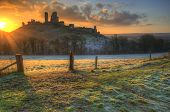 Vibrant Winter Landscape Sunrise Over Castle Ruins