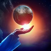 pic of longitude  - Hand of businessman holding earth planet against illustration background - JPG