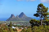 stock photo of mauritius  - The city at the bottom of mountains - JPG