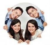 pic of peep hole  - Portrait of happy smiling young business team peeping through the hole - JPG