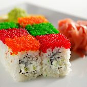 Tobiko Rainbow Maki Sushi - Roll with various type of Tobiko (flying fish roe) outside. Cream Cheese