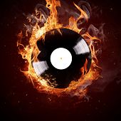image of disc jockey  - Burning vinyl disc - JPG