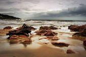 Stormy Beachfront With Wood Stump