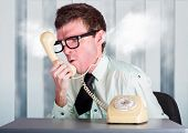 Unhappy Nerd Businessman Yelling Down Retro Phone
