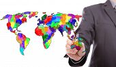Businessman drawing colorful map of world