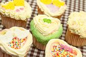 image of san valentine  - Valentine heart shaped cupcakes on a tablecloth - JPG