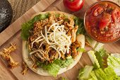 picture of shredded cheese  - Homemade Mexican Flatbread Taco with meat lettuce cheese and salsa - JPG