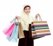 image of muslimah  - Happy young muslim woman with shopping bag isolated over white background - JPG
