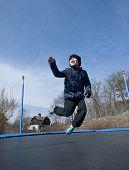 Fun On Trampoline At Springtime