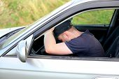 picture of nod  - tired man fall asleep in a car - JPG