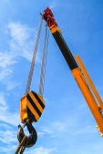 picture of big-rig  - Hydraulic crane beams working against blue sky - JPG