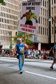 Man Carries Sign Urging Sinners To Repent At Atlanta Parade