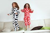 foto of pajamas  - Children in soft warm pajamas playing at home - JPG