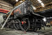 stock photo of locomotive  - Old Locomotive Parking In A repair station - JPG