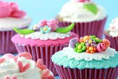 picture of sugar paste  - close up of beautiful colorful wedding cupcakes - JPG