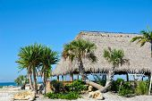 stock photo of tiki  - Beach Tiki Hut Bar on the Ocean - JPG