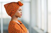 stock photo of traditional attire  - fashionable african businesswoman wearing traditional clothes in office - JPG