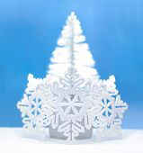 Shinny Christmas Tree and White Snowflakes over Blue Background