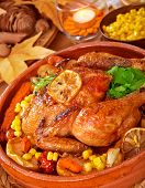 Tasty fried chicken served with fresh vegetables, good roasted chick with crunchy crust, homemade baked poultry, delicious food concept, Thanksgiving dinner