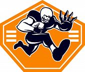 picture of stiff  - Illustration of an american football gridiron running back player running with ball facing front fending putting out a stiff arm set inside shield done in retro style - JPG