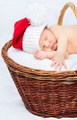 Cute Newborn Baby Wearing Santa Claus Hat Sleeping In Basket, Christmas, New Year