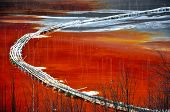 Natural disaster. Pollution of a lake with contaminated water from a gold mine