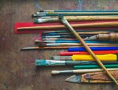 image of bristle brush  - Set of paint brushes and office supplies on the table close - JPG