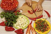 Cutting red chili pepper