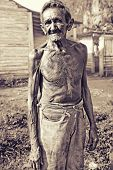 sepia portrait of poor farmer of tobacco plantation, cuba