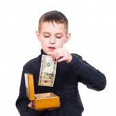 Close Up Portrait Of Boy Counting Money