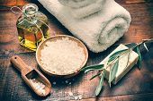 pic of sea salt  - Spa setting with natural olive soap and sea salt on wooden table - JPG