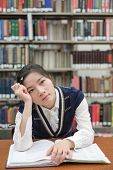 Student With Open Textbook Deep In Thought