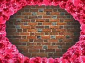 frame from roses and background from red brick wall