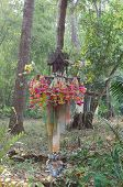 Spirit House In Thailand With Flowers In Vases And Some Wreathes,  House Joss