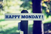 stock photo of monday  - Happy monday signpost in beautiful woodland with a vintage instagram style filter effect - JPG