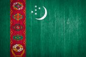 image of turkmenistan  - Turkmenistan Flag on wood background and texture - JPG