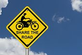 picture of traffic rules  - Share the Road Warning Sign An road warning sign with words Share the Road and a motorcycle icon with blue sky background - JPG