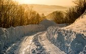 Snowdrifts And Rural Road At Sunrise. Petropavlovsk-kamchatsky In March. Kamchatka, Russia