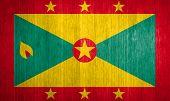 Grenada Flag On Wood Background
