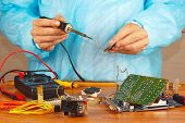 Soldering electronic hardware in service workshop
